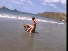 sally layd on the beach in retro movie scene scene
