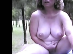 mature nude male outdoors on table extended